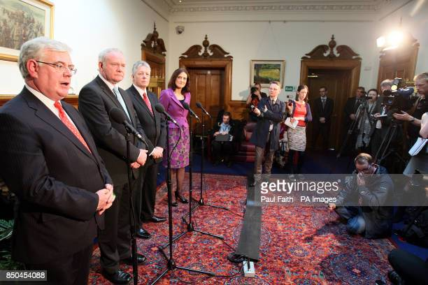 Tanaiste Eamon Gilmore speaking at Stormont Castle with Northern Ireland Secretary Theresa Villers with First Minister Peter Robinson and Deputy...