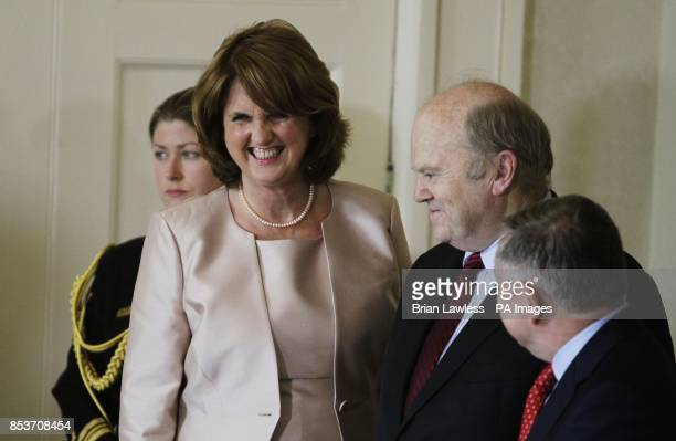 Tanaiste Joan Burton with Minster for Finance Michael Noonan and Minster for Public Expenditure and Reform Brendan Howlin at Aras an Uachtarain...