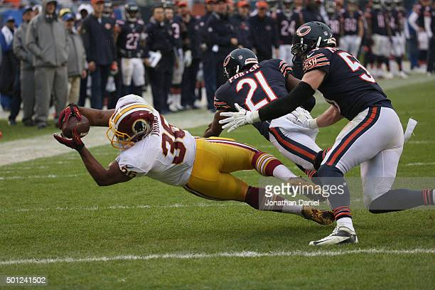 Tanard Jackson of the Washington Redskins is tackled short of the goal by Ryan Mundy and Shea McClellin of the Chicago Bears at Soldier Field on...