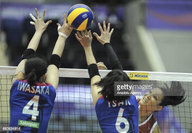 Tandara Caixeta of Osasco Voleibol Clube in action against Nana Iwasaka and Yuki Ishii of Hisamitsu Spring during the semifinals match of the FIVB...
