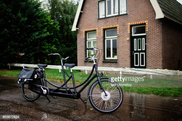 Tandem bicycle near the house