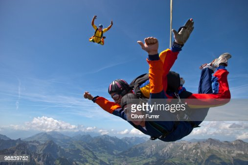 Tandem couple having fun in the sky together. : Stock Photo