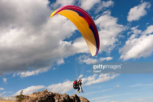 Tandem paraglider starting a flight