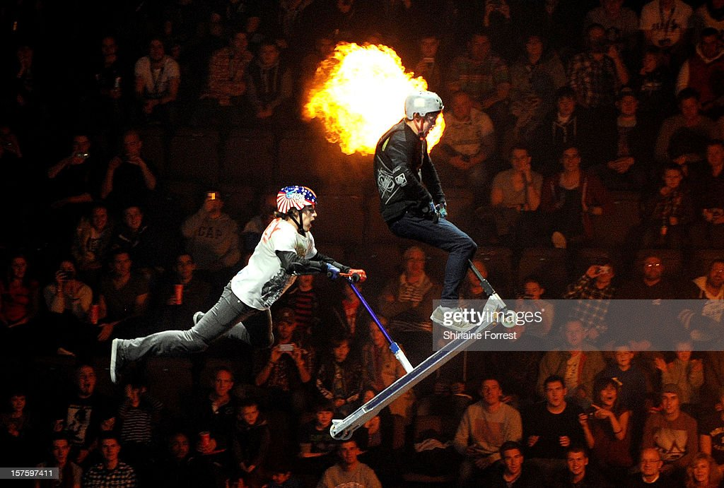 Tandem scooter riders at Nitro Circus Live at Manchester Arena on December 4, 2012 in Manchester, England.