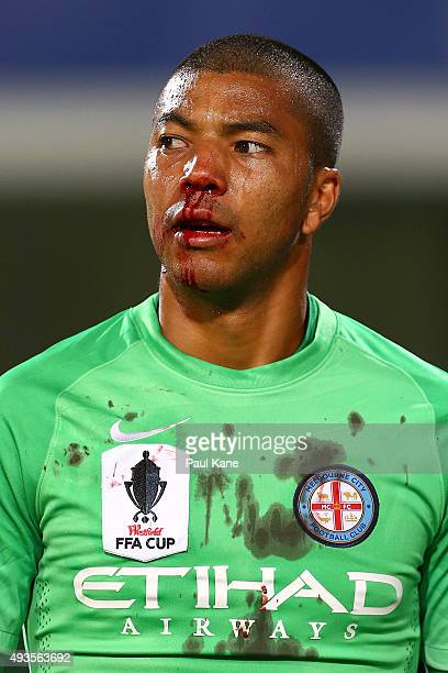 Tando Velaphi of Melbourne walks from the field after a goal square clash with Guyon Fernandez of the Glory during the FFA Cup Semi Final match...