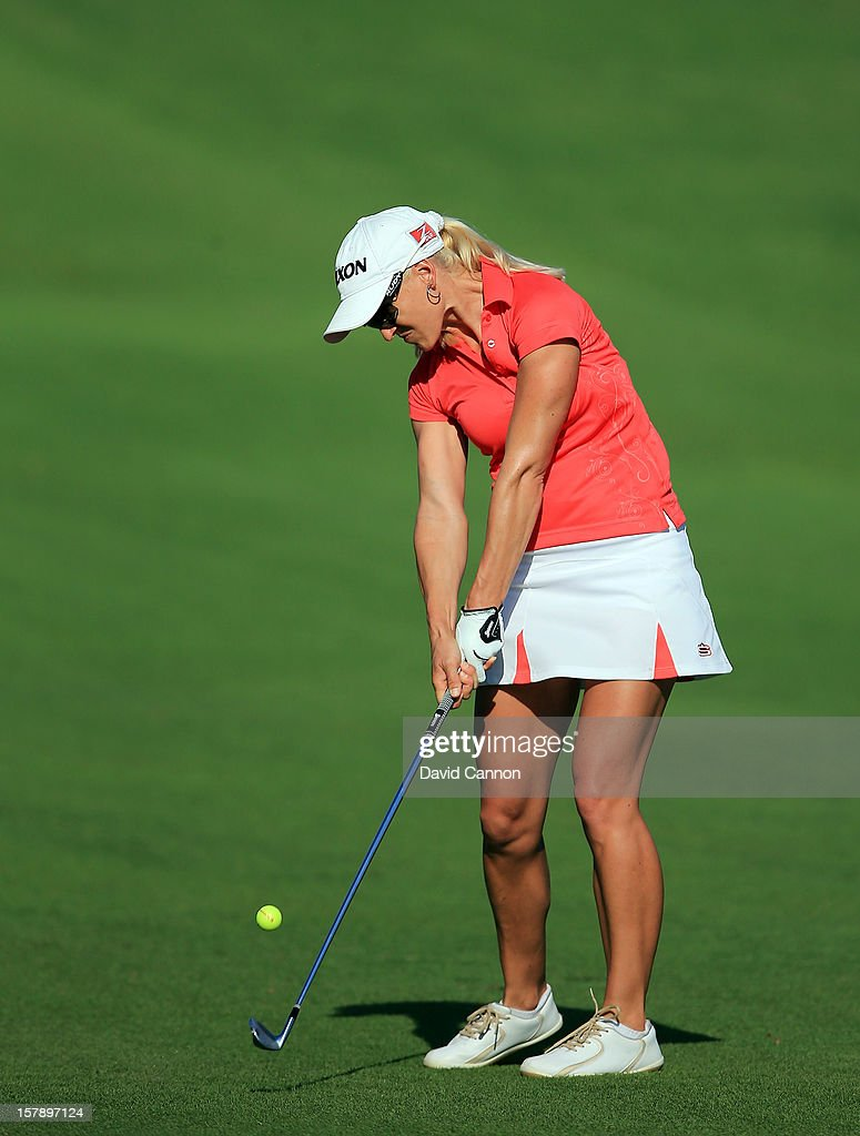 Tandy Cunningham of South Africa plays her second shot at the par 4, 14th hole during the third round of the 2012 Omega Dubai Ladies Masters on the Majilis Course at the Emirates Golf Club on December 7, 2012 in Dubai, United Arab Emirates.