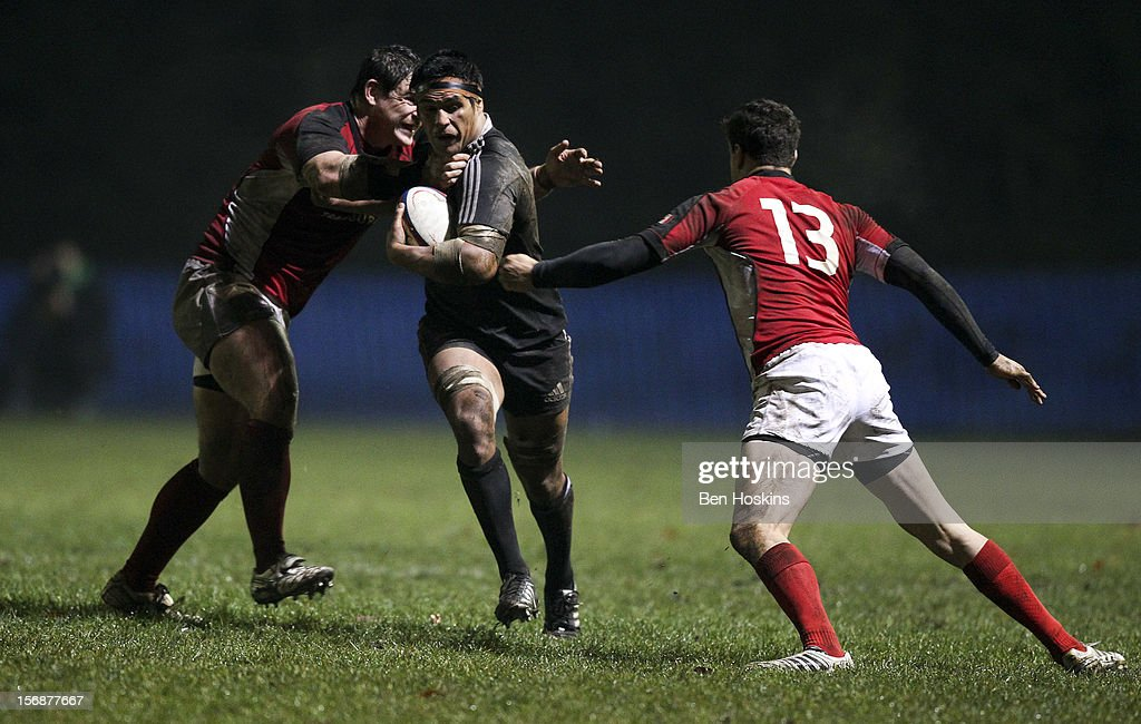 Tanerau Latimer of the Maori All Blacks is tackled by Tyler Ardron (L) and Ciaran Hearn (R) of Canada during a tour match between Canada and Maori All Blacks at Oxford University Rugby Club on November 23, 2012 in Oxford, England.