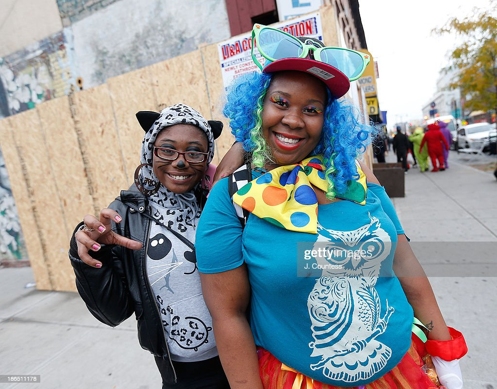 Tanesha Hicks and Amber Graham of BedfordÐStuyvesant pose for a photo in the heart of 'Bedstuy' as they 'Trick or Treat' in Brooklyn on October 31, 2013 in New York City.