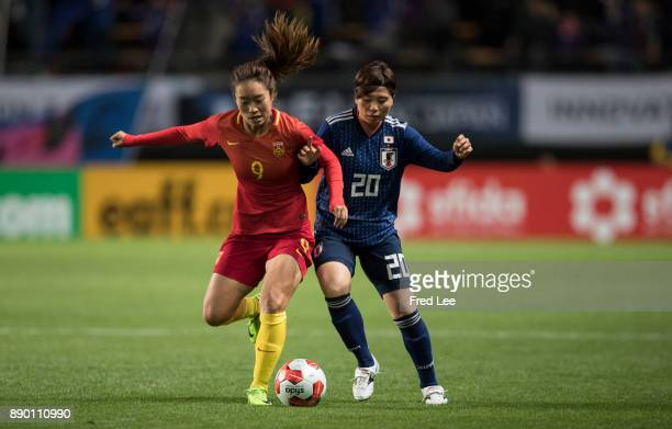 Tang jiali of China and Manya Miho of Japan in action during the EAFF E1 Women's Football Championship between Japan and China at Fukuda Denshi Arena...