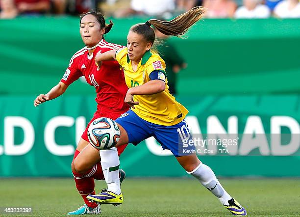 Tang Jiali of China PR challenges Andressa of Brazil at Commonwealth Stadium on August 5 2014 in Edmonton Canada