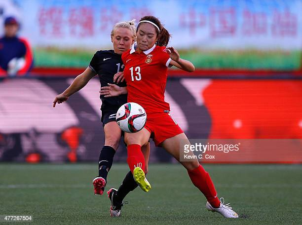 Tang Jiali of China PR challenges Betsy Hassett of New Zealand during the FIFA Women's World Cup Canada 2015 Group A match between China PR and New...