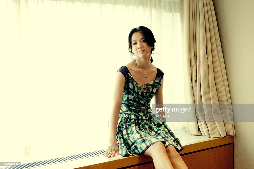 Tang Wei poses for photographs at the 'Wu Xia' portrait session during the Busan International Film Festival on October 10, 2011 in Busan, South Korea.