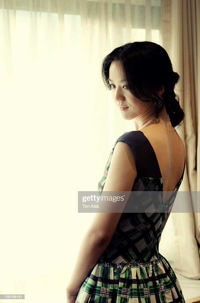 <a gi-track='captionPersonalityLinkClicked' href=/galleries/search?phrase=Tang+Wei&family=editorial&specificpeople=4329520 ng-click='$event.stopPropagation()'>Tang Wei</a> poses for photographs at the 'Wu Xia' portrait session during the Busan International Film Festival on October 10, 2011 in Busan, South Korea.