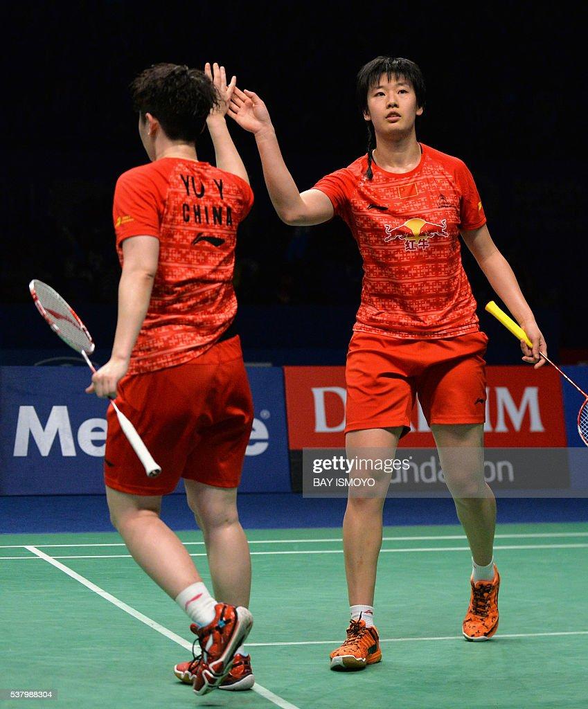 Tang Yuanting R and Yu Yang L of China react after a point