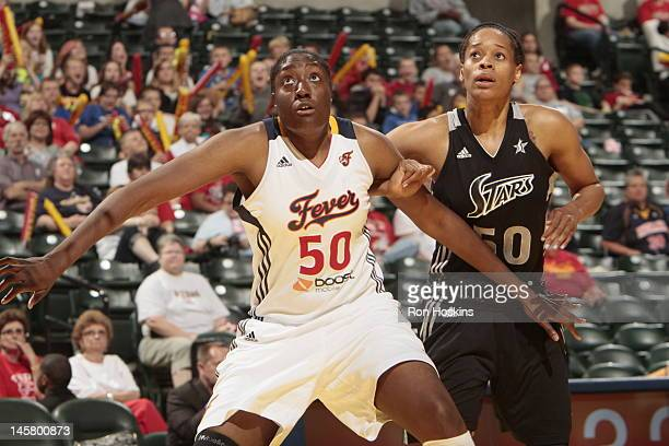 Tangela Smith of the San Antonio Silver Stars fights for position against Jessica Davenport of the indiana Fever at Banker Life Fieldhouse on May 9...