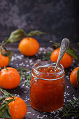 Tangerine jam in a glass jar.A traditional dessert at Christmas and New year.
