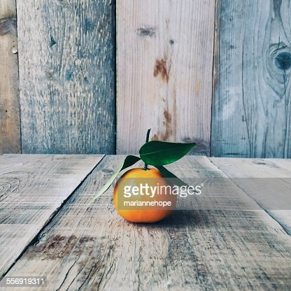 Tangerine on a wooden table