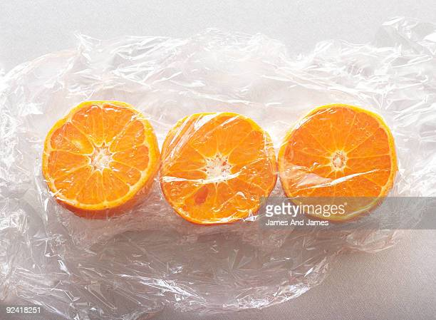 Tangerines Wrapped in Plastic Wrap