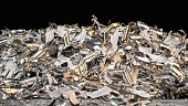 Close-up of the pile of manufacturing metallic chips. Idea of industry, mechanical engineering, machining. Metal swarf, filings, flakes, trash or waste