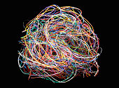 Tangled ball of colored wires against black