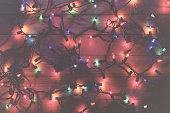 Tangled colorful Christmas light strands