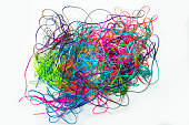 A wad of colorful tangled lanyard strings.