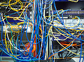 A tangled mess of network cables
