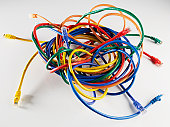 Tangled nest of colorful Ethernet cords