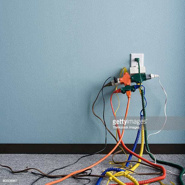 Tangled power cords and electrical outlet