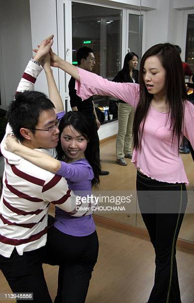 Tango in Beijing China on December 17 2007Chinese people learn Chachacha in a dancing school in Beijing Foreign dances such as TangoSalsaand even...