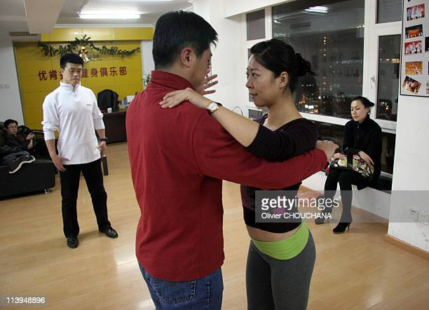 Tango in Beijing China on December 17 2007Chinese people learn Tango in a dancing school in Beijing Foreign dances such as TangoSalsaand even HipHop...