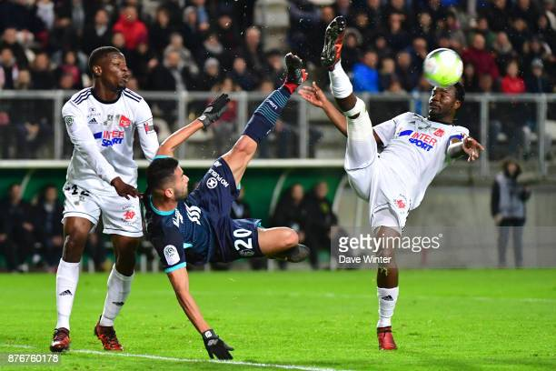 Tanguy Ndombele of Amiens Thiago Maia of Lille and Guy Ngosso of Amiens during the rescheduled Ligue 1 match between Amiens SC and Lille OSC at Stade...