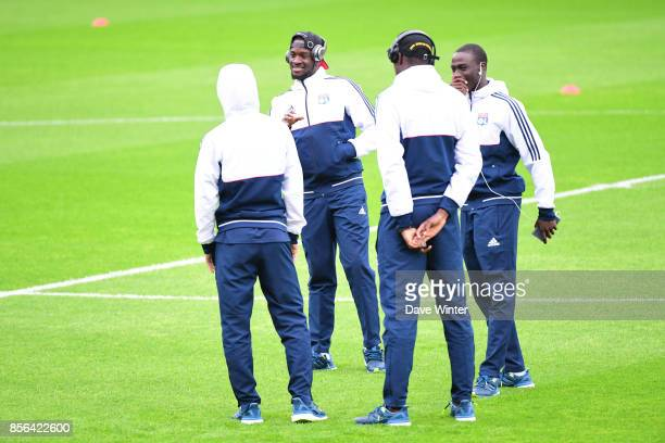 Tanguy Ndombele of Lyon shares a joke with teammates before the Ligue 1 match between Angers SCO and Olympique Lyonnais at Stade Raymond Kopa on...