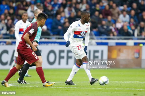 Tanguy Ndombele of OL and Geronimo Poblete of Metz during the Ligue 1 match between Olympique Lyonnais and Fc Metz at Parc Olympique on October 29...