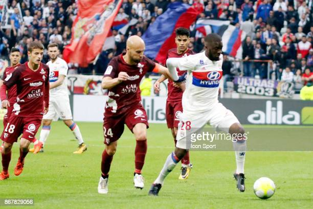 Tanguy Ndombele of OL and Renaud Cohade of Metz during the Ligue 1 match between Olympique Lyonnais and Fc Metz at Parc Olympique on October 29 2017...