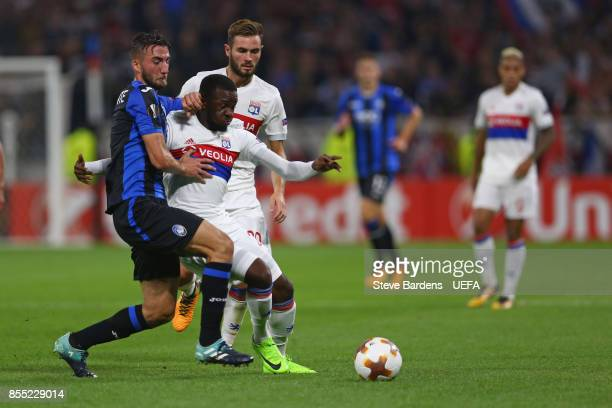 Tanguy Ndombele of Olympique Lyonnais Lyon challenges for the ball with Bryan Cristante of Atalanta during the UEFA Europa League group E match...