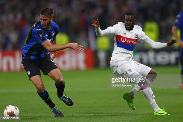 Tanguy Ndombele of Olympique Lyonnais Lyon looses the ball to Bryan Cristante of Atalanta during the UEFA Europa League group E match between...