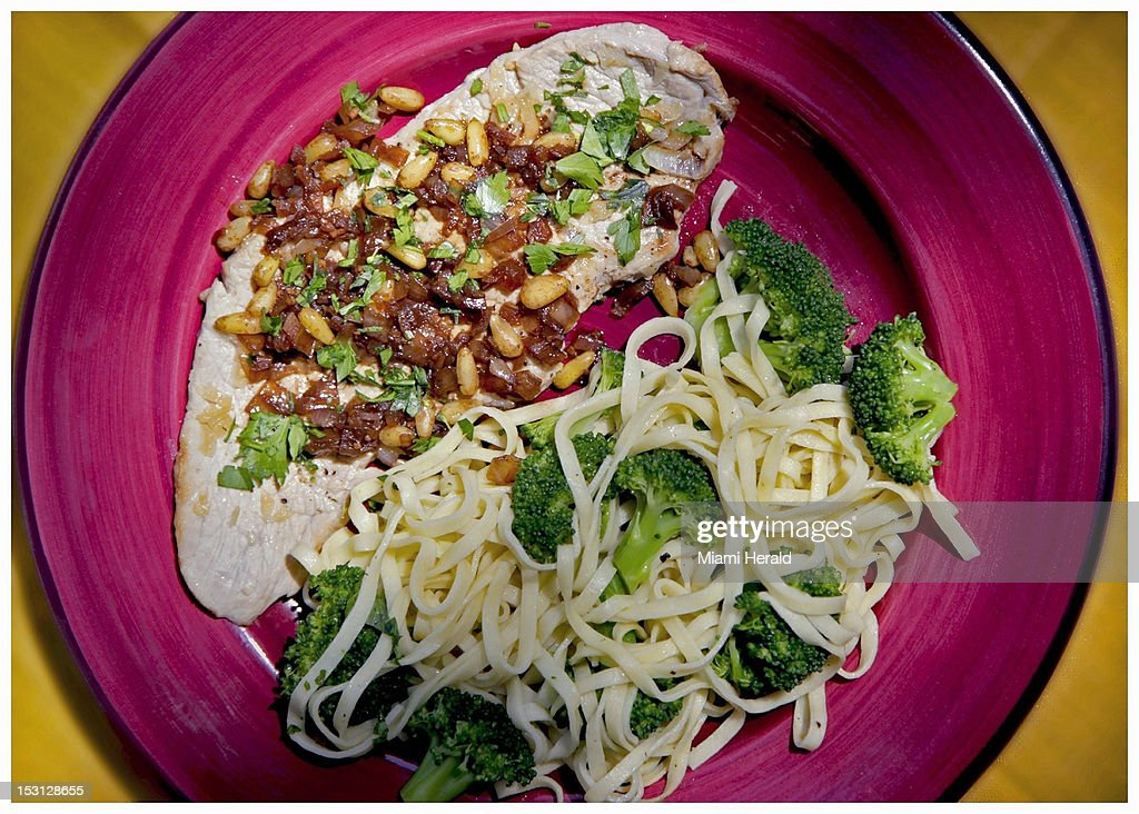 Tangy sauce of onions, pine nuts, and balsamic vinegar tops veal cutlets served with linguine and broccoli.