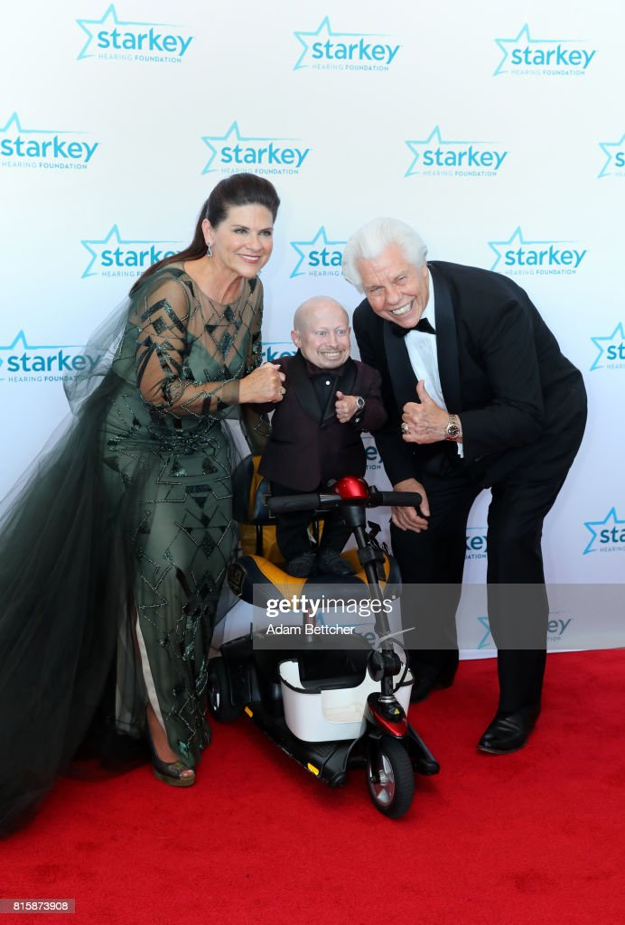 Tani Austin, Verne Troyer, and Bill Austin pose on the red carpet at the 2017 Starkey Hearing Foundation So the World May Hear Awards Gala at the Saint Paul RiverCentre on July 16, 2017 in St. Paul, Minnesota.