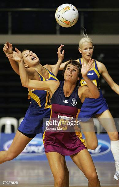 Tania Dalton of Southland eyes the ball as Hannah Broederlow of Otago reaches from behind during the Scottwood Trust Netball Championships match...