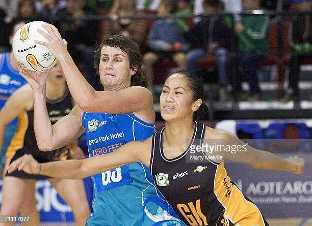 Tania Dalton of the Sting takes a pass with Gerardine Solia of the Shakers in defence during the Bartercard Cup match between the Wellington Shakers...