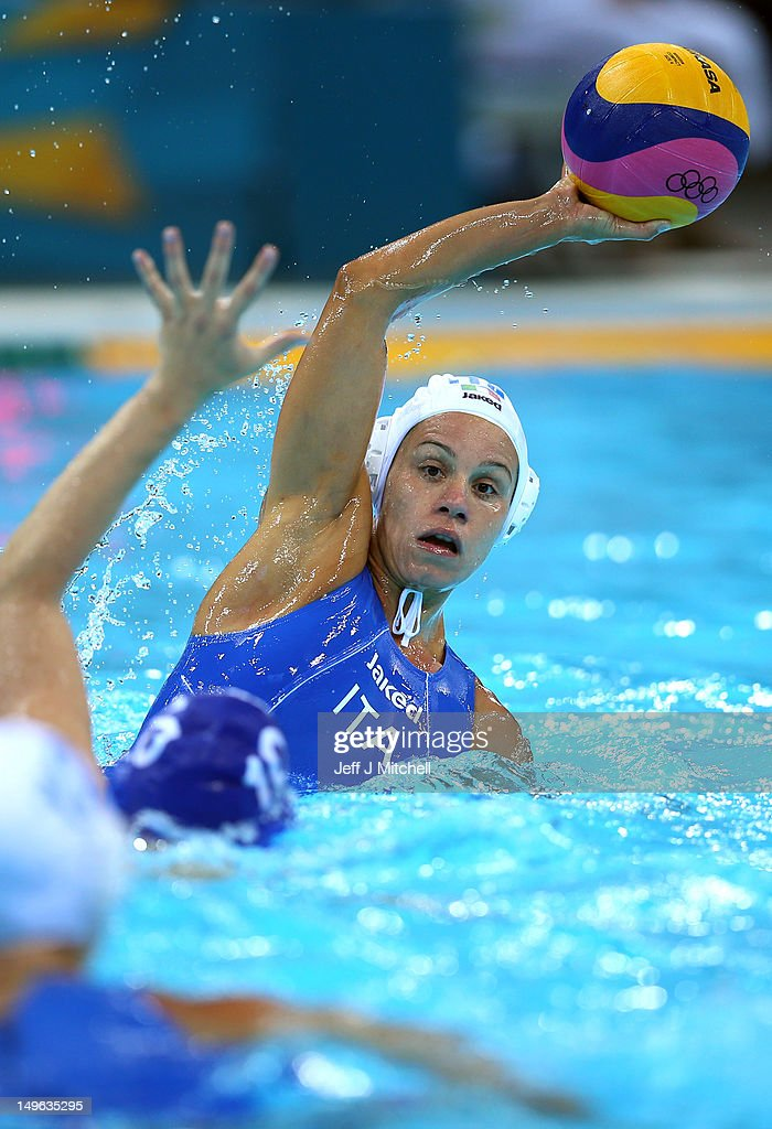 Tania di Mario #7 of Italy passes the ball in the Women's Preliminary Round match between Italy and Russia on Day 5 of the London 2012 Olympics at Water Polo Arena on August 1, 2012 in London, England.