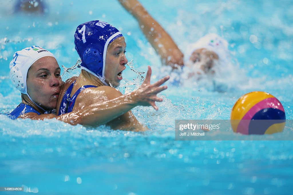 Tania di Mario of Italy tackles Ekterina Lisunova of Russia on Day 5 of the London 2012 Olympics at Water Polo Arena on August 1, 2012 in London, England.