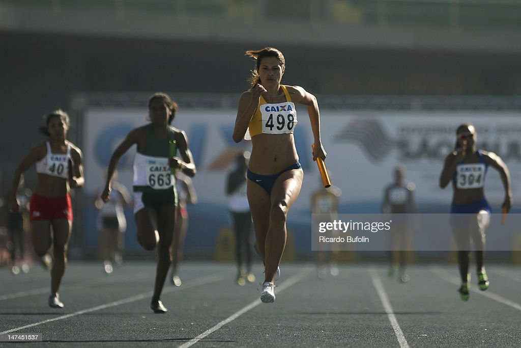 Tania Ferreira da Silva (#498), Kauiza Moreira Venancio (#304), Giselle Marculino de Albuquerque (#663) and Jessica Carolina Alves dos Reis (#401), from Brazil, competes in the 4 × 400 Meters Relay Semifinal event during the third day of the Trofeu Brazil/Caixa 2012 Track and Field Championship at Ícaro de Castro Mello Stadium on June 29, 2012 in Ibirapuera, Sao Paulo, Brazil.