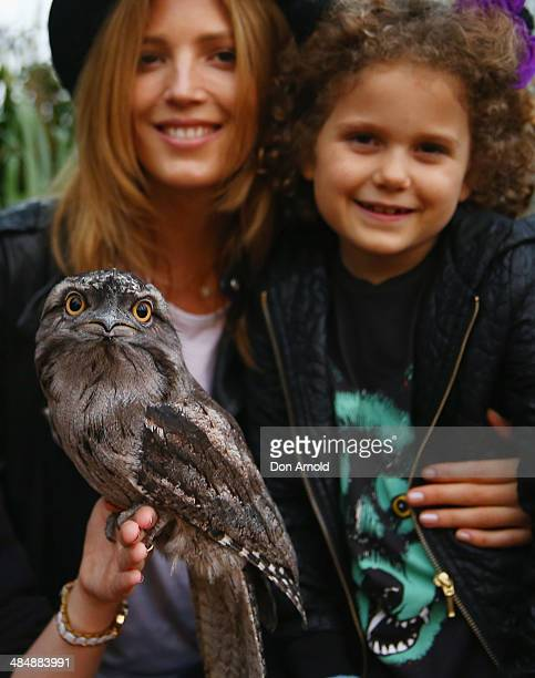 Tania Gacic poses alongside a Tawny Frogmouth and her daughter Cocoa Pavlovich at the EMU Australia Celebrity Children's event at Sydney Wild Life...