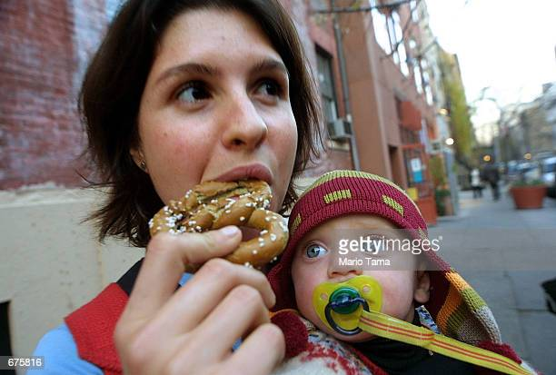 Tania Gladstone tries out a hemp pretzel as Sintra Howell looks on at a stand promoting hemp products December 4 2001 in New York City The DEA...