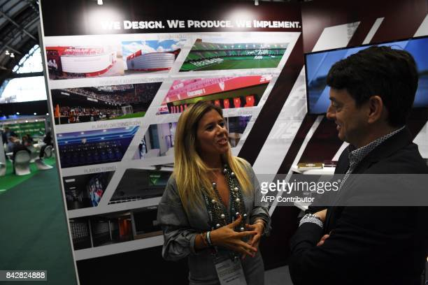 Tania Ribeiro Cunha and Fran Carrasco of Molca World talk at their company's trade stand during the Soccerex Global Convention 2017 in Manchester...