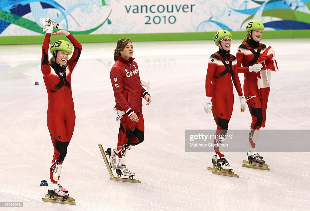 Tania Vicent Kalyna Roberge Marianne StGelais and Jessica Gregg of Canada celebrate winning the silver medal in the Short Track Speed Skating Ladies'...