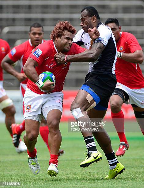 Taniela Moa of Tonga is tackled by Sireli Bobo of Fiji during their rugby match in the Pacific Nations Cup in Tokyo on June 23 2013 Fiji defeated...
