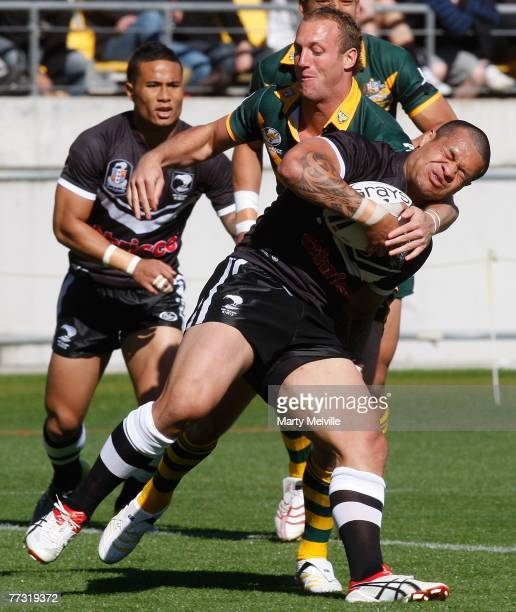 Taniela Tuiaki of the Kiwis gets tackled by Mark Gasnier of the Kangaroos during the Centennial Test match between the New Zealand Kiwis and the...